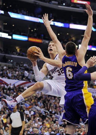 Los Angeles Clippers forward Blake Griffin (32) shoots as Los Angeles Lakers forward Josh McRoberts defends during the first half of their NBA basketball game, Wednesday, April 4, 2012, in Los Angeles. (AP Photo/Mark J. Terrill)