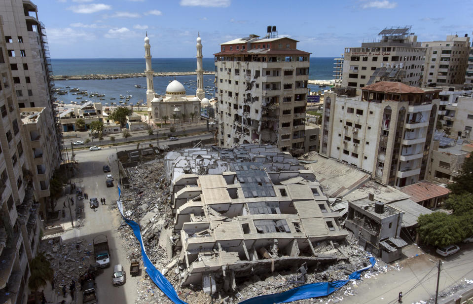 Rubble of a destroyed building scatters the ground after it was hit last week by Israeli airstrikes, in Gaza City, Saturday, May 22, 2021. (AP Photo/Khalil Hamra)
