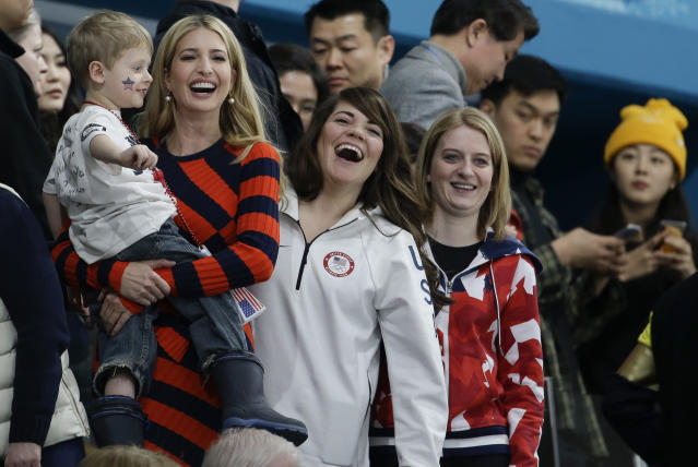 Ivanka Trump, daughter of U.S. President Donald Trump, left, holds a children beside United States' curler Becca Hamilton, center, as they watch the men's final curling match between United States and Sweden at the 2018 Winter Olympics in Gangneung, South Korea, Saturday, Feb. 24, 2018. (AP Photo/Natacha Pisarenko)