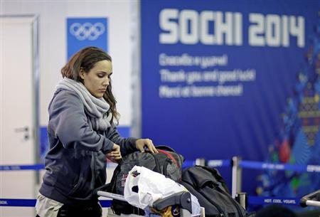 Women's bobsleigh brakeman Lolo Jones of the U.S. arrives at the Coastal Athletes Village for the 2014 Sochi Winter Olympics