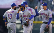 New York Mets shortstop Francisco Lindor (12) celebrates with teammates after the first game of a baseball doubleheader against the Colorado Rockies on Saturday, April 17, 2021, in Denver. The Mets won 4-3. (AP Photo/David Zalubowski)