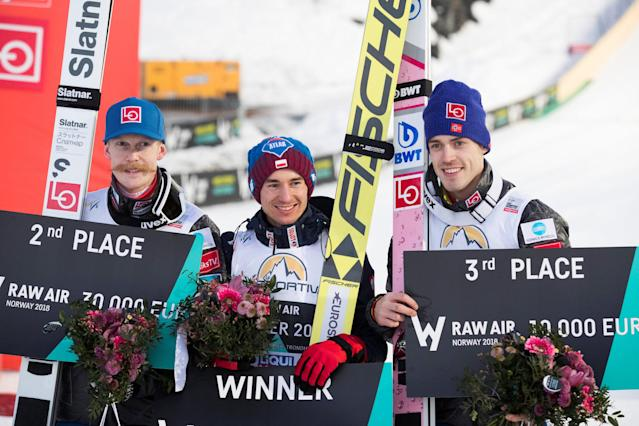 Ski Jumping - FIS World Cup - Men's HS240 - Vikersund, Norway - March 18, 2018. Raw Air overall winner Kamil Stoch of Poland celebrates on the podium with second-placed Robert Johansson of Norway and Andreas Stjernen of Norway. NTB Scanpix/Terje Bendiksby via REUTERS ATTENTION EDITORS - THIS IMAGE WAS PROVIDED BY A THIRD PARTY. NORWAY OUT. NO COMMERCIAL OR EDITORIAL SALES IN NORWAY.