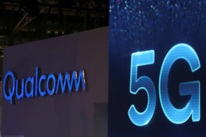 FILE PHOTO: Qualcomm and 5G logos are seen at the Mobile World Congress in Barcelona