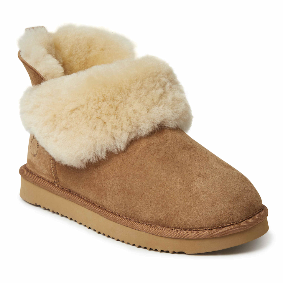"""Since she's not going anywhere anytime soon, you might as well give her the gift of comfort. <br><br><strong>Dearfoams</strong> Perth Genuine Shearling Foldover Boot Slipper, $, available at <a href=""""https://go.skimresources.com/?id=30283X879131&url=https%3A%2F%2Fwww.dearfoams.com%2Fwomens-perth-genuine-shearling-foldover-boot-slipper%2F75136-FSBX-00001-10.html"""" rel=""""nofollow noopener"""" target=""""_blank"""" data-ylk=""""slk:Dearfoams"""" class=""""link rapid-noclick-resp"""">Dearfoams</a>"""
