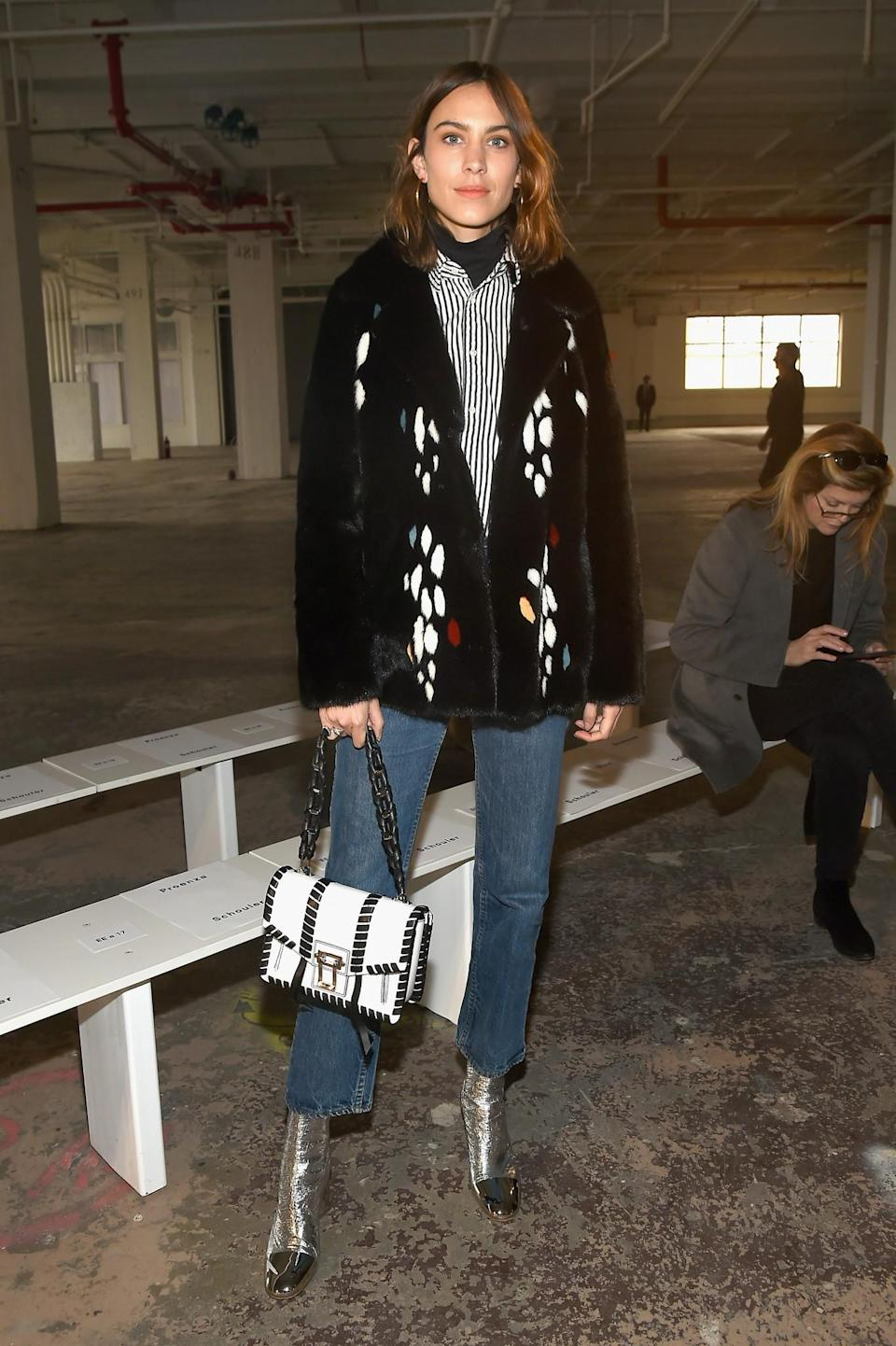 <p>Alexa Chung donned a furry jacket, jeans and metallic boots. <i>[Photo: Getty]</i> </p>