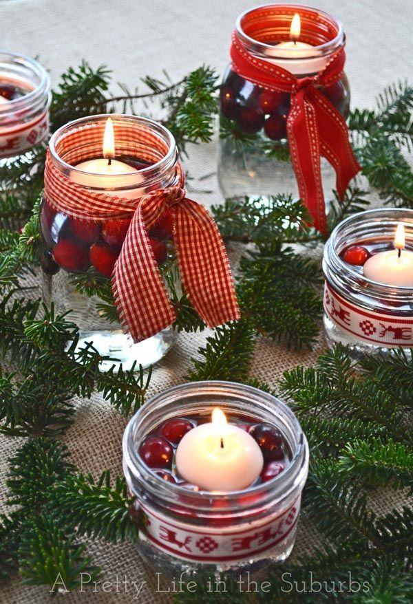 "<p>Dress up the tables at your barn wedding with greenery interspersed with these adorable Mason jars filled with cranberries and floating candles. It's inexpensive yet totally rustic chic! </p><p><strong>See more at <a href=""https://aprettylifeinthesuburbs.com/simple-pretty-christmas-centrepieces/"" rel=""nofollow noopener"" target=""_blank"" data-ylk=""slk:A Pretty Life in the Suburbs"" class=""link rapid-noclick-resp"">A Pretty Life in the Suburbs</a>.</strong></p>"