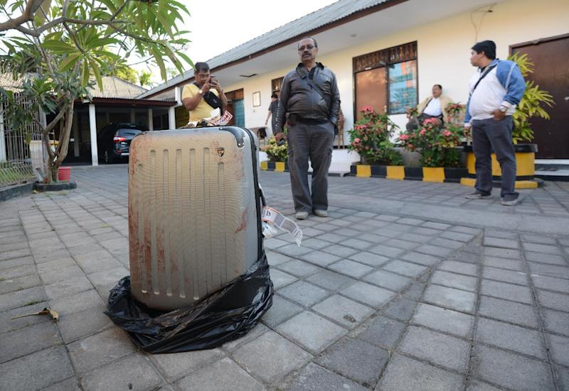 The suitcase in which the body of a US tourist was found is pictured at a police station on the Indonesian resort island of Bali on August 12, 2014 (AFP Photo/Sonny Tumbelaka)