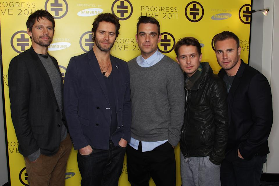 LONDON, ENGLAND - OCTOBER 26: L-R Jason Orange, Howard Donald, Robbie Williams, Mark Owen and Gary Barlow of Take That attend a press conference to announce their new stadium tour Progress Live 2011 held at The Savoy Hotel on October 26, 2010 in London, England. (Photo by Dave Hogan/Getty Images)