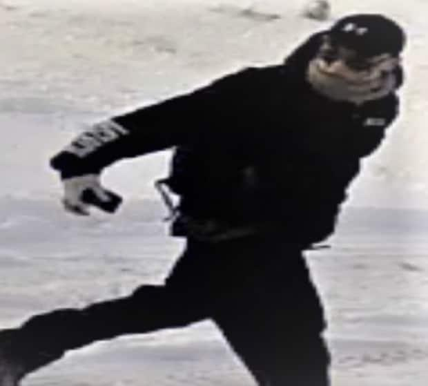 A still image from security video shows a suspect fleeing the scene of a homicide in Chestermere, Alta., in November 2018.  (RCMP - image credit)