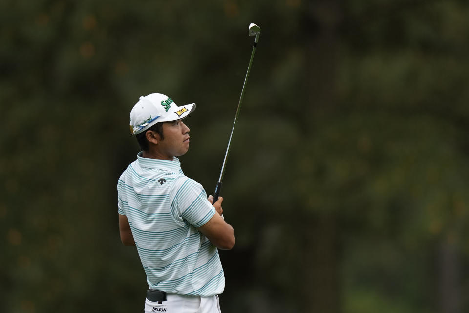 Hideki Matsuyama, of Japan, watches his shot on the 15th hole during the third round of the Masters golf tournament on Saturday, April 10, 2021, in Augusta, Ga. (AP Photo/David J. Phillip)