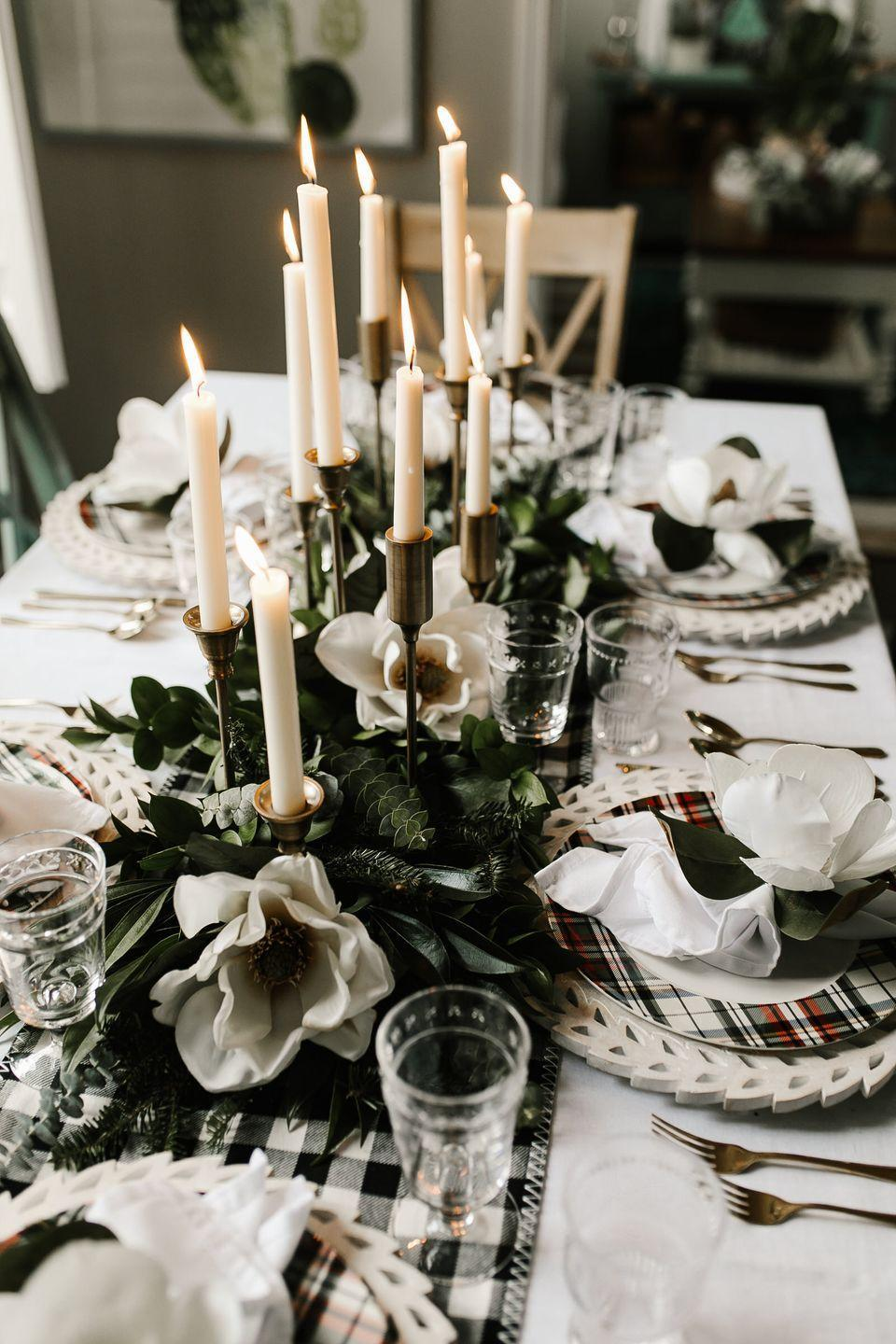 "<p>Poinsettias and holly are the plants of the season, but they run the risk of feeling a tad...<em>predictable.</em> To shake things up, add some leafy greens and magnolia blossoms to your centerpiece.<br></p><p><a href=""https://kbstyled.com/2018/12/christmas-tablescape/"" rel=""nofollow noopener"" target=""_blank"" data-ylk=""slk:Via KBStyled"" class=""link rapid-noclick-resp""><em>Via KBStyled</em></a></p>"