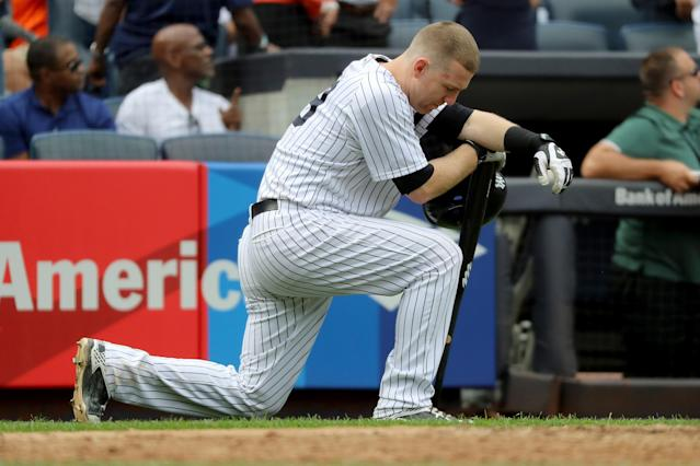Todd Frazier of the New York Yankees reacts after a child was hit by a foul ball off his bat in the fifth inning against the Minnesota Twins. (Getty Images)