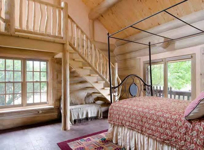 """<p>The 3,400-square-foot Log House has two bedrooms and three baths.<i> <i>(Photo: <a href=""""http://bit.ly/1oZ16Zz"""" rel=""""nofollow noopener"""" target=""""_blank"""" data-ylk=""""slk:Swan Land Company"""" class=""""link rapid-noclick-resp"""">Swan Land Company</a>)</i><br></i></p>"""