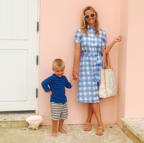 "<p>With her son Tennessee in a <a rel=""nofollow"" href=""http://www.draperjames.com/midi-shirtdress#"">Draper James midi shirt dress</a>.</p>"