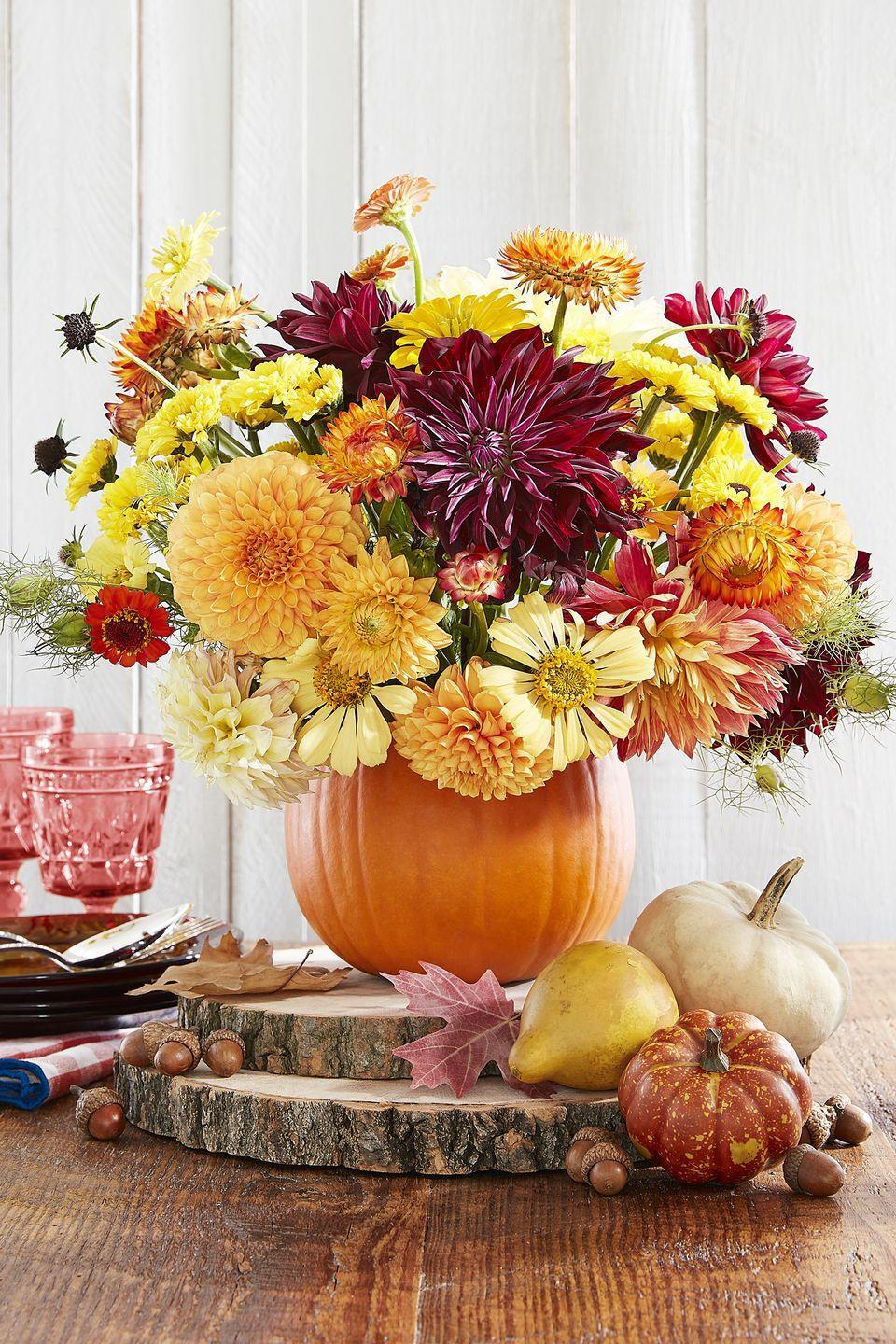 "<p>Cut the top off a pumpkin, scoop out the inside, and fill with floral foam and flowers for a stunning <a href=""https://www.countryliving.com/entertaining/g2130/thanksgiving-centerpieces/"" rel=""nofollow noopener"" target=""_blank"" data-ylk=""slk:DIY Thanksgiving centerpiece"" class=""link rapid-noclick-resp"">DIY Thanksgiving centerpiece</a>.</p><p><a class=""link rapid-noclick-resp"" href=""https://go.redirectingat.com?id=74968X1596630&url=https%3A%2F%2Fbouqs.com%2F&sref=https%3A%2F%2Fwww.countryliving.com%2Fentertaining%2Fg2063%2Fthanksgiving-craft-ideas%2F"" rel=""nofollow noopener"" target=""_blank"" data-ylk=""slk:SHOP FLOWERS"">SHOP FLOWERS</a></p>"