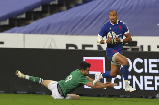 France's Gael Fickou, right evades the tackle of Ireland's Conor Murray during the Six Nations rugby union international match between France and Ireland in Paris, France, Saturday, Oct. 31, 2020. (AP Photo/Thibault Camus)