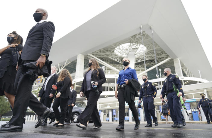 FBI personnel and law enforcement representatives leave a memorial service for Special Agent Laura Schwartzenberger, Saturday, Feb. 6, 2021, in Miami Gardens, Fla. Schwartzenberger and Special Agent Daniel Alfin were killed while serving a warrant this week in Sunrise, Fla. (AP Photo/Hans Deryk)