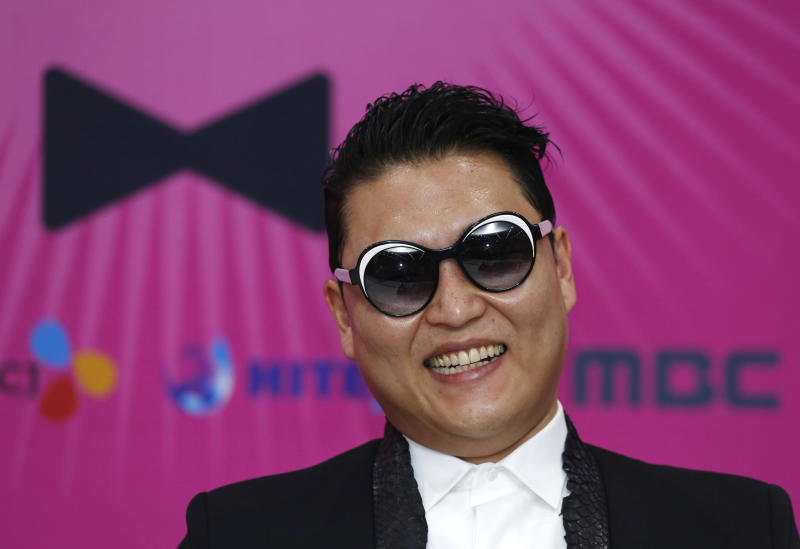 """South Korean rapper PSY smiles during a news conference for his concert """"Happening"""" in Seoul, South Korea Saturday, April 13, 2013. PSY is unveiling the music video and choreography for his new single """"Gentleman"""" at the Seoul concert. (AP Photo/Kin Cheung)"""