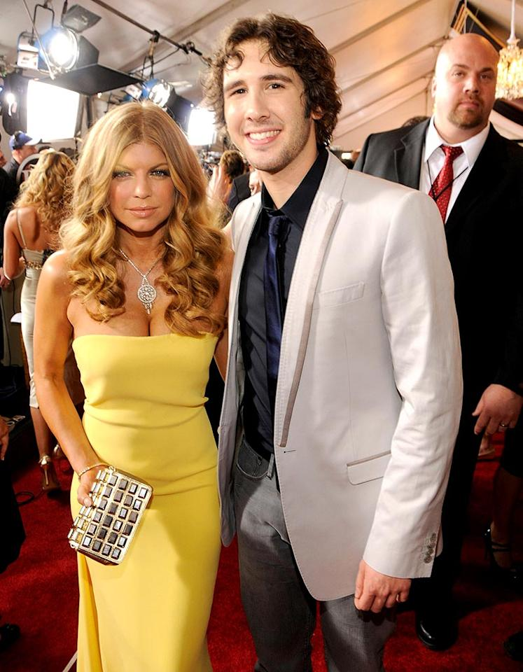 "It looked like Fergie's mind was elsewhere while posing for a pic with singer/songwriter Josh Groban. Kevin Mazur/<a href=""http://www.wireimage.com"" target=""new"">WireImage.com</a> - February 10, 2008"