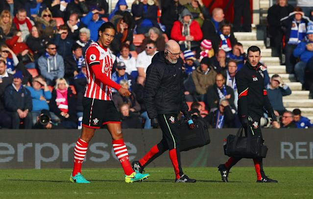 <p>Virgil van Dijk walks off with an injury against Leicester </p>