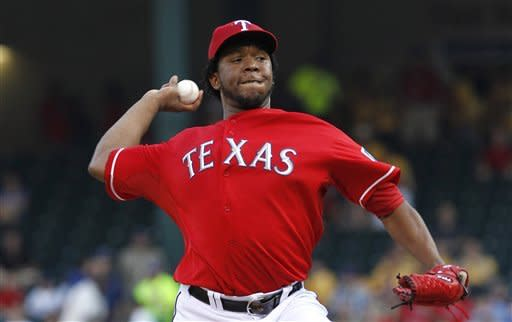 Texas Rangers starting pitcher Neftali Feliz winds up during the first inning of a baseball game against the Seattle Mariners on Tuesday, April 10, 2012, in Arlington, Texas. (AP Photo/LM Otero)