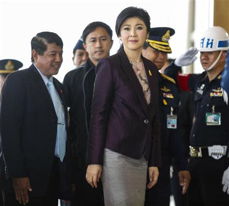 Thailand Prime Minister Yingluck Shinawatra (C) arrives at the Royal Thai Air Force headquarters before a cabinet meeting in Bangkok February 11, 2014. REUTERS/Athit Perawongmetha