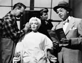 <p>Lana Turner pays a visit to the makeup chair to get done up for her scene in <em>The Bad and the Beautiful </em>in 1952. </p>