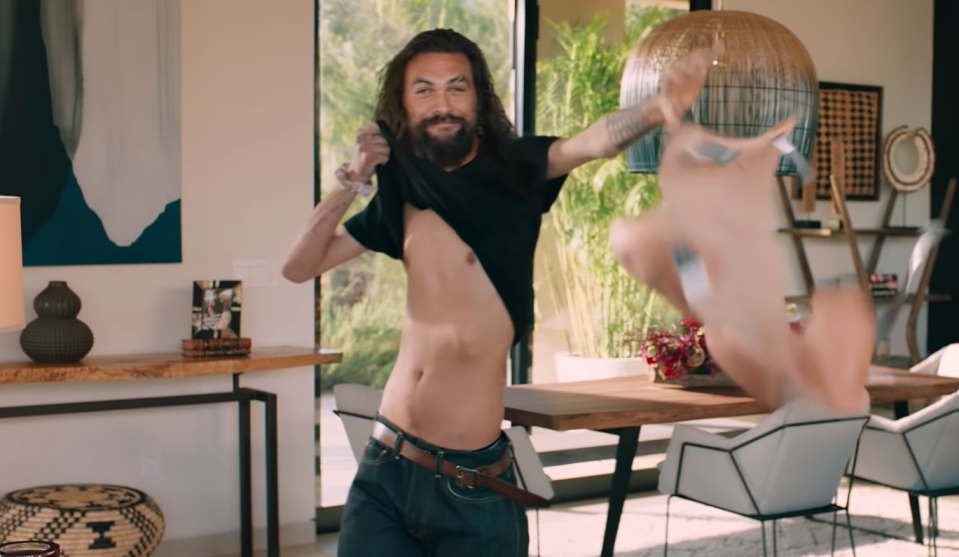 Momoa's ripped physique gets ripped away in his Super Bowl ad. (Rocket Mortgage/YouTube)