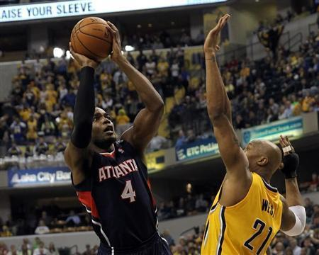 Apr 6, 2014; Indianapolis, IN, USA; Atlanta Hawks forward Paul Millsap (4) shoots over Indiana Pacers forward David West (21) during the first quarter at Bankers Life Fieldhouse. Pat Lovell-USA TODAY Sports