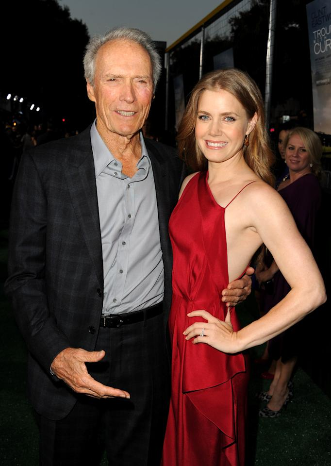 """WESTWOOD, CA - SEPTEMBER 19:  Actor/Producer Clint Eastwood and actress Amy Adams arrive at Warner Bros. Pictures' """"Trouble With The Curve"""" premiere at Regency Village Theatre on September 19, 2012 in Westwood, California.  (Photo by Kevin Winter/Getty Images)"""