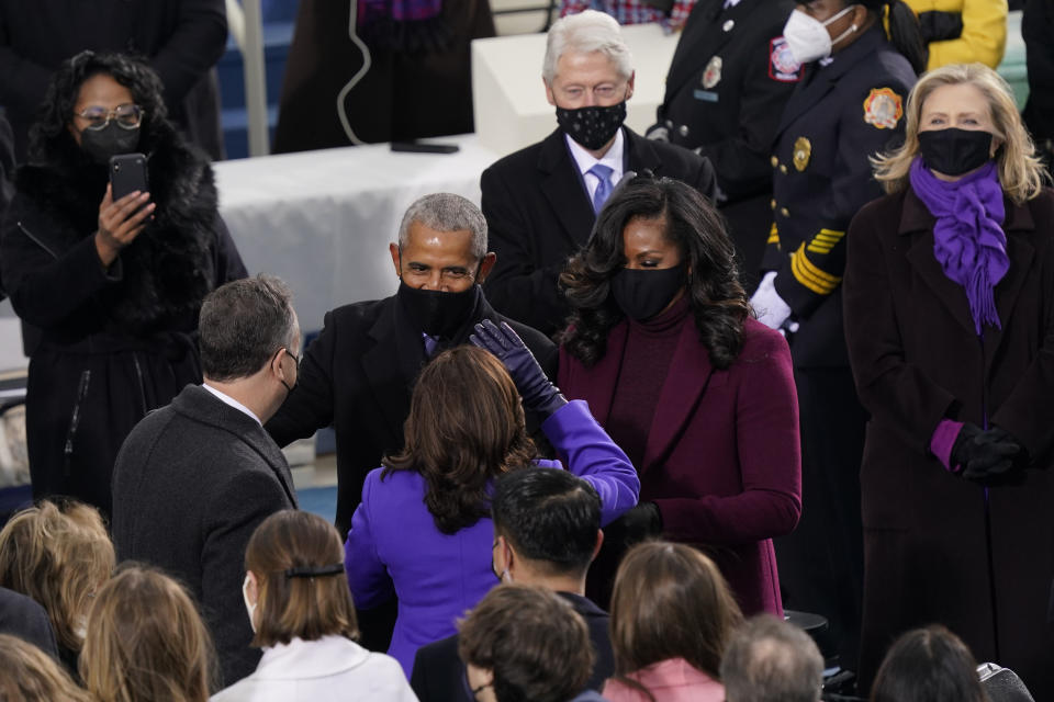 Vice President-elect Kamala Harris and her husband Doug Emhoff talk with former President Barack Obama and his wife Michelle as they arrive for the 59th Presidential Inauguration at the U.S. Capitol in Washington, Wednesday, Jan. 20, 2021. (AP Photo/Carolyn Kaster)