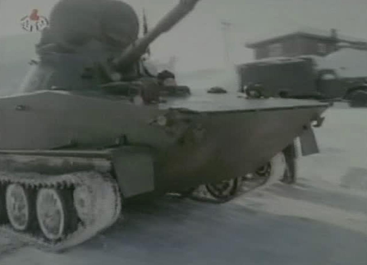 """In this undated image made from KRT video, North Korea's new young leader Kim Jong Un rides in a military vehicle at an undisclosed place in North Korea, aired Sunday, Jan. 8, 2012. Kim Jong Un, who was named """"supreme leader"""" of North Korea's people, ruling Workers' Party and military following the death last month of his father, Kim Jong Il, was shown observing firing exercises and posing for photographs with soldiers in footage that was shot before his father's death and aired as a documentary Sunday. (AP Photo/KRT via APTN) TV OUT, NORTH KOREA OUT"""