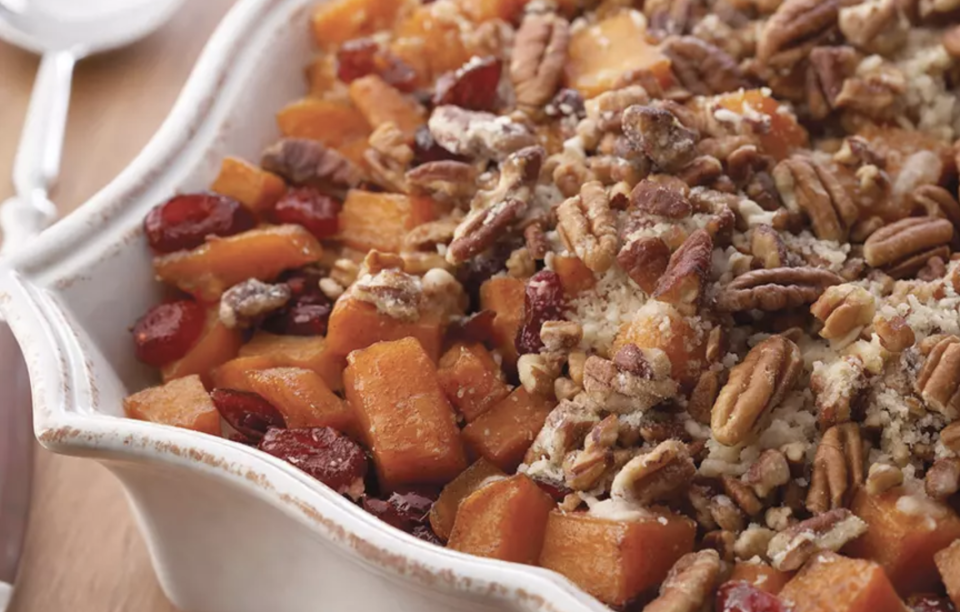"""<p>This hearty dish uses the ultimate fall superfood, sweet potatoes, with an added extra crunch of pecans. Bright orange sweet potatoes contain high amounts of magnesium, which is known as one of the best minerals for promoting relaxation, calmness and a better mood. </p> <p><a href=""""https://www.thedailymeal.com/recipe/roasted-sweet-potatoes-pecans?referrer=yahoo&category=beauty_food&include_utm=1&utm_medium=referral&utm_source=yahoo&utm_campaign=feed"""" rel=""""nofollow noopener"""" target=""""_blank"""" data-ylk=""""slk:For the Roasted Sweet Potatoes With Cinnamon Pecan Crunch recipe, click here."""" class=""""link rapid-noclick-resp"""">For the Roasted Sweet Potatoes With Cinnamon Pecan Crunch recipe, click here. </a></p>"""