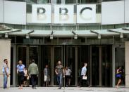 FILE PHOTO: People arrive and depart from Broadcasting House, the headquarters of the BBC in London