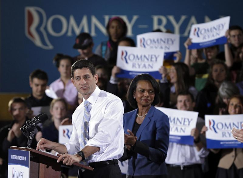 Republican vice presidential candidate, Rep. Paul Ryan, R-Wis., accompanied by former Secretary of State Condoleezza Rice, speaks at a campaign rally at Baldwin Wallace University in Berea, Ohio, Wednesday, Oct. 17, 2012. (AP Photo/Mark Duncan)