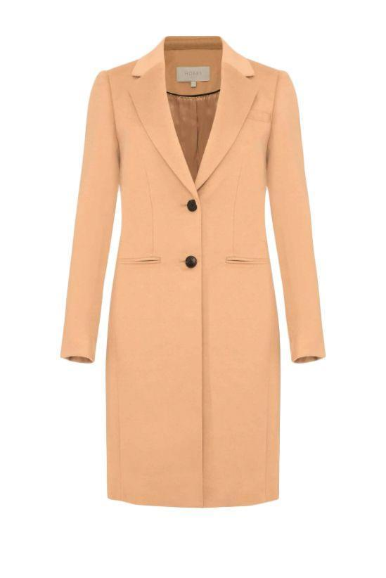 """<p><a class=""""link rapid-noclick-resp"""" href=""""https://www.hobbs.com/product/tilda-wool-collar-coat/0220-3528-1049L00-CAMEL.html"""" rel=""""nofollow noopener"""" target=""""_blank"""" data-ylk=""""slk:SHOP NOW"""">SHOP NOW</a></p><p>Thanks to its neat knee-length hemline, Hobbs' camel coat won't swamp shorter frames. The tailored shape and notch lapels will keep this one feeling classic forever.</p><p>Wool Camel Coat, £239.20, Hobbs</p>"""