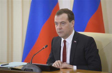 Russia's Prime Minister Dmitry Medvedev chairs a government meeting in the Crimean city of Simferopol, March 31, 2014. REUTERS/RIA Novosti/Alexander Astafyev/Pool