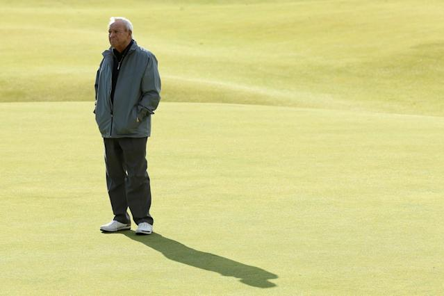 <p>Arnold Palmer of the United States stands on the 18th green during the Champion Golfers' Challenge ahead of the 144th Open Championship at The Old Course on July 15, 2015 in St Andrews, Scotland. (Photo by Mike Ehrmann/Getty Images) </p>