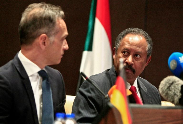 German Foreign Minister Heiko Maas (L) and Sudan's Prime Minister Abdallah Hamdok give a joint press conference in the Sudanese capital Khartoum on Tuesday