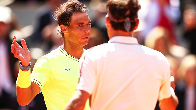 Rafael Nadal and Roger Federer, pictured here after playing at the 2019 French Open.