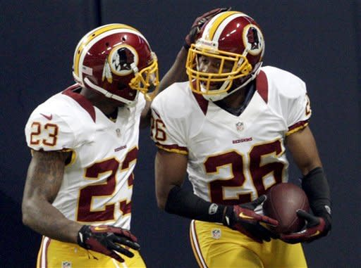 Washington Redskins cornerback Josh Wilson, right, is congratulated by DeAngelo Hall after running a fumble back for a touchdown during the first quarter of an NFL football game against the St. Louis Rams, Sunday, Sept. 16, 2012, in St. Louis. (AP Photo/Tom Gannam)