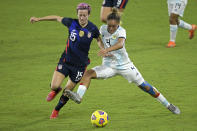 United States forward Megan Rapinoe (15) and Argentina defender Marina Delgado (4) compete for a ball during the second half of a SheBelieves Cup women's soccer match, Wednesday, Feb. 24, 2021, in Orlando, Fla. (AP Photo/Phelan M. Ebenhack)