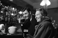 <p>A couple enjoys a beer at The Park Tavern in Penge, London. Due its strange shape, it was locally referred to as The Coffin. The pub closed in 2015. </p>