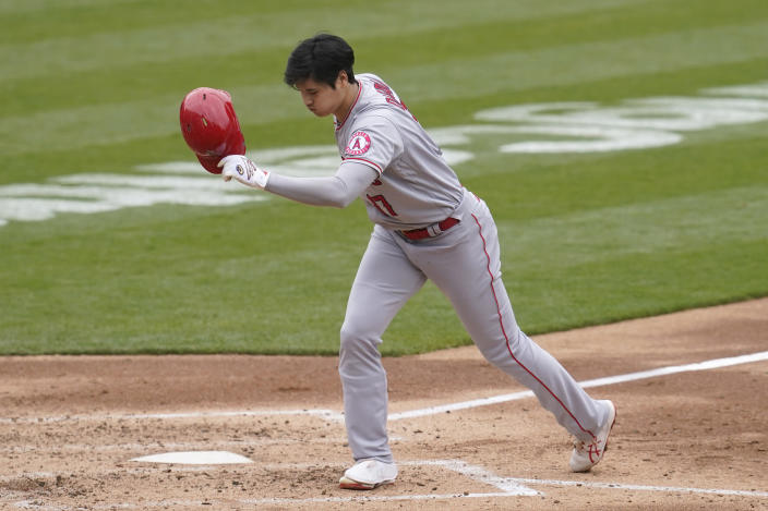 Los Angeles Angels' Shohei Ohtani holds his helmet after striking out against the Oakland Athletics during the fourth inning of a baseball game in Oakland, Calif., Saturday, May 29, 2021. (AP Photo/Jeff Chiu)