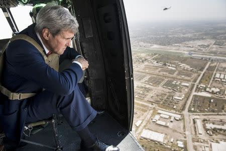 U.S. Secretary of State John Kerry looks out over Baghdad from a helicopter September 10, 2014. REUTERS/Brendan Smialowski/Pool