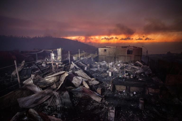 A wildfire ravaged woods before spreading into the Chilean port city of Valparaiso and destroying 100 homes