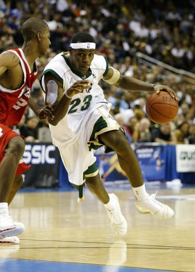 WESTWOOD, CA – JANUARY 4: LeBron James @@#23 of the St. Vincent–St. Mary Fighting Irish drives against D.J. Strawberry.