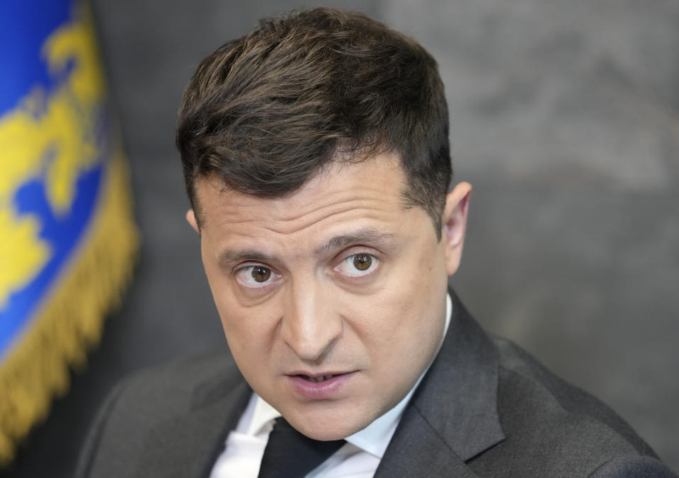 FILE - In this June 14, 2021, file photo Ukrainian President Volodymyr Zelenskyy gestures while speaking to the media during a news conference in Kyiv, Ukraine. The United States is promising up to $60 million in military aid to Ukraine in advance of White House meeting on Wednesday, Sept. 1, between President Joe Biden and his counterpart in Kyiv, Volodymyr Zelenskyy. . (AP Photo/Efrem Lukatsky, File)