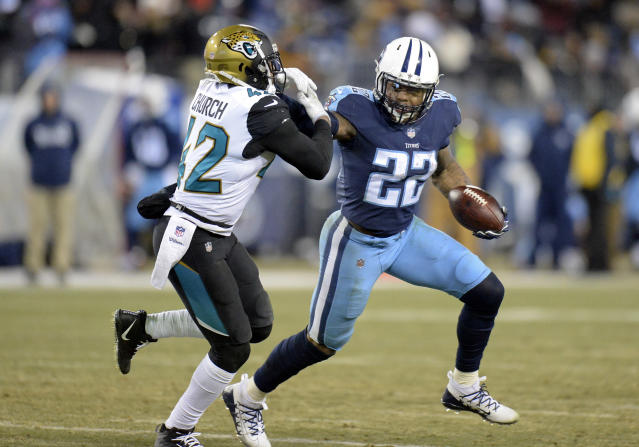 Tennessee running back Derrick Henry tries to get past Jacksonville Jaguars safety Barry Church in the second half of a 15-10 victory that puts the Titans back in the playoffs for the first time in nearly a decade. (AP Photo)