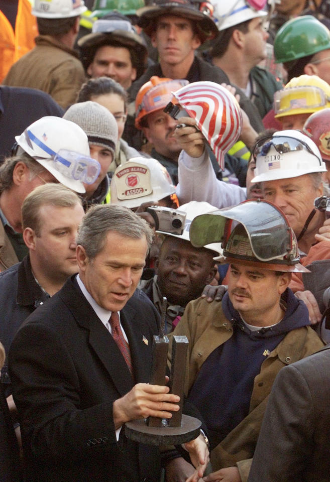 U.S. President George W. Bush looks at a model of the World Trade Center as he meets with rescuers at Ground Zero at the World Trade Center after a memorial service in New York, November 11, 2001. (REUTERS/Larry Downing LSD/ME)